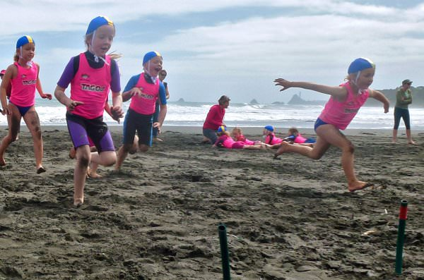 Never too young for surf life saving and fun on the beaches of Taranaki.